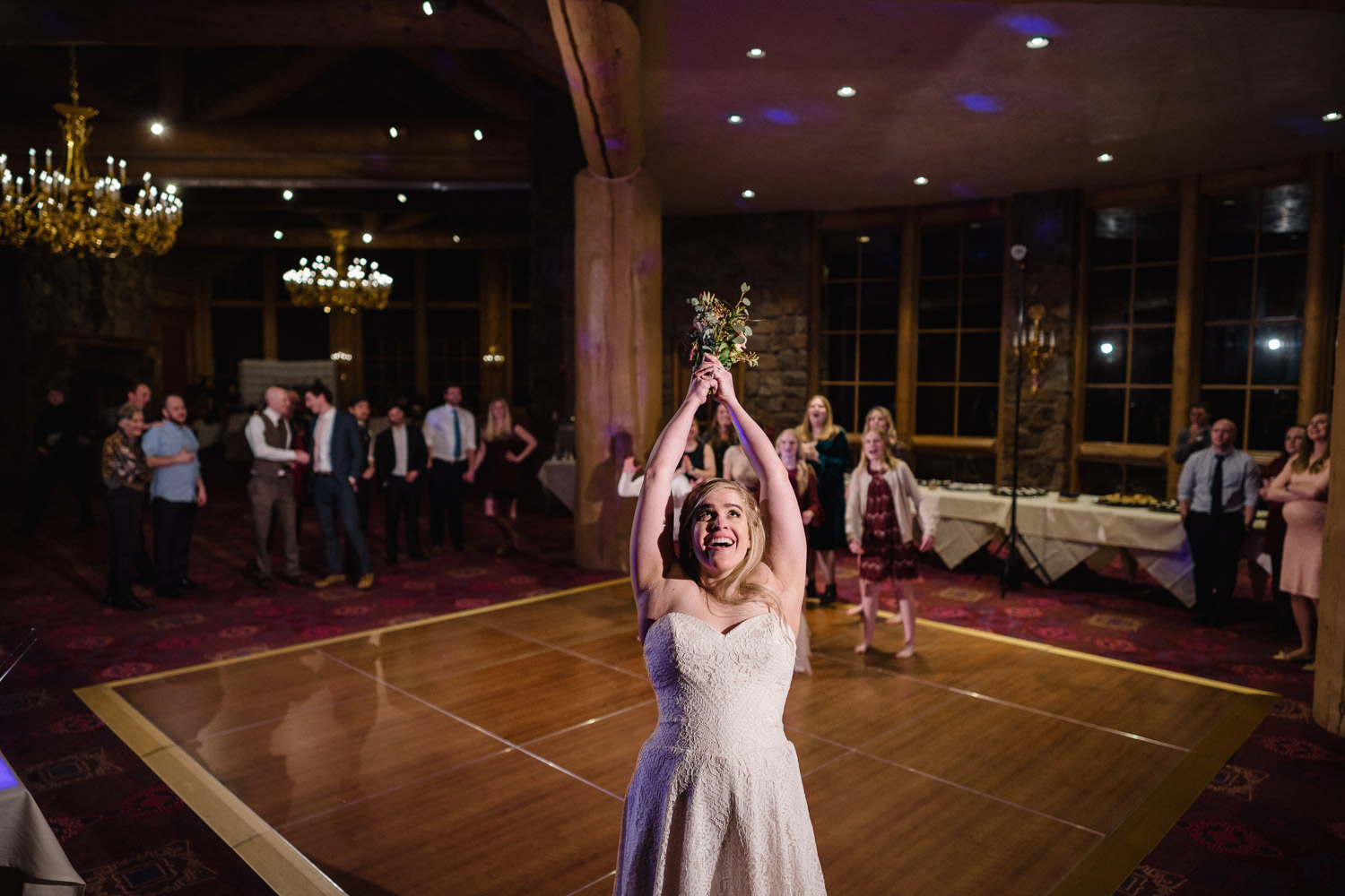 bride tosses bouquet snowbasin resort wedding