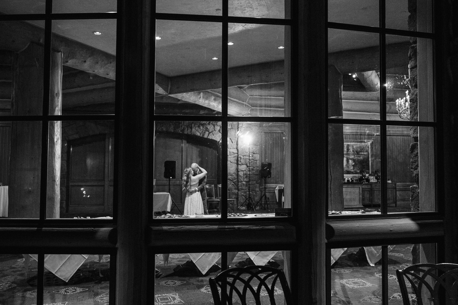 bride and groom dancing through window snowbasin resort