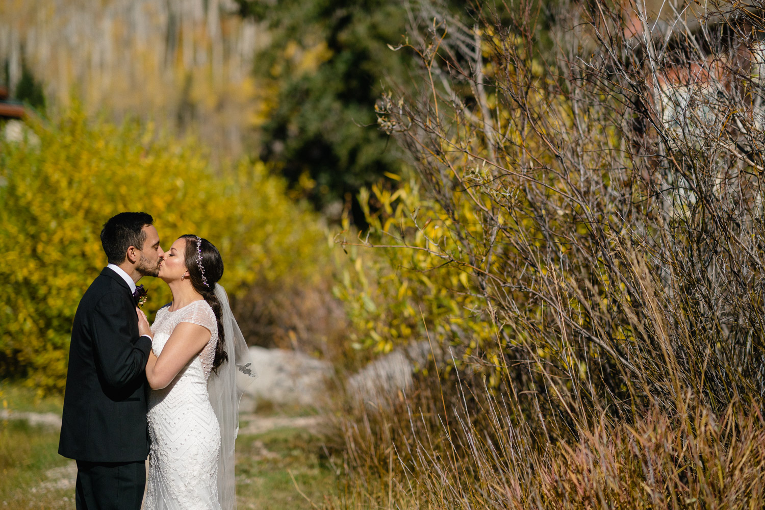 happy couple kissing in fall scene solitude resort