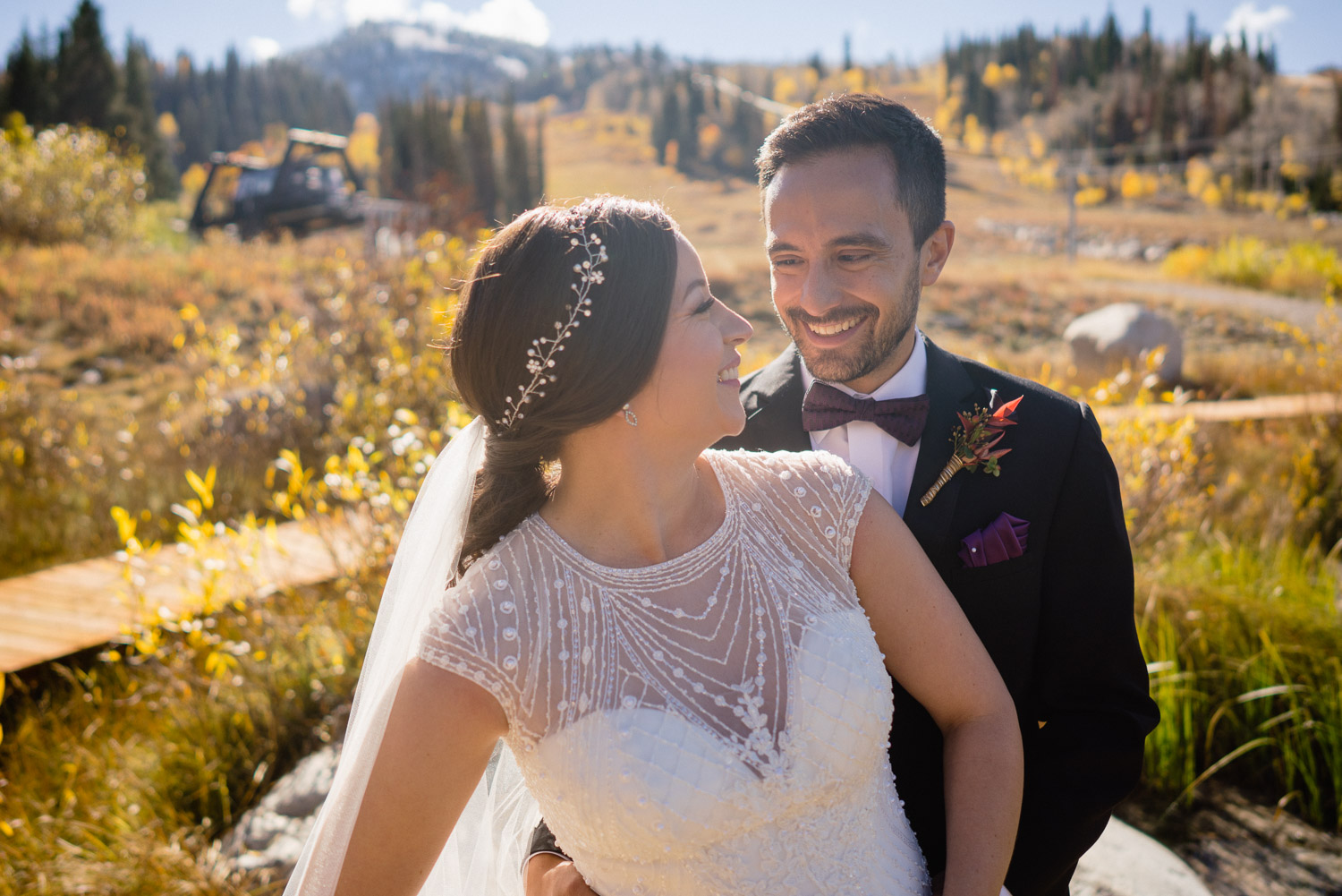 bride and groom looking at each other in fall weather wedding
