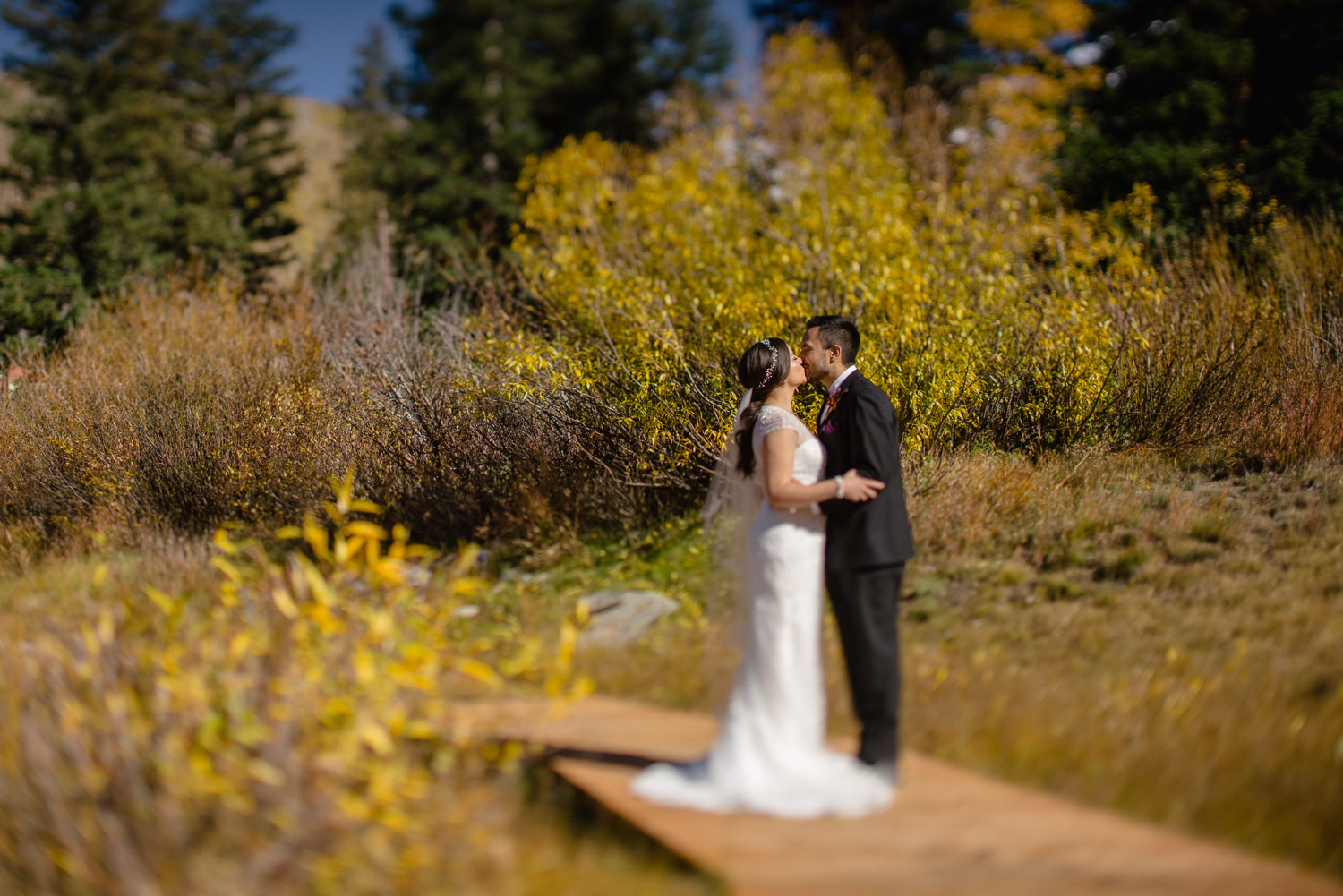 bride and groom kissing on bridge fall wedding solitude resort