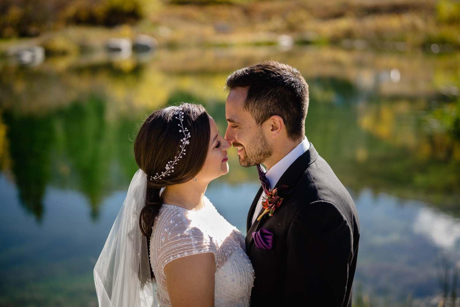 bride and groom embracing outside fall wedding solitude