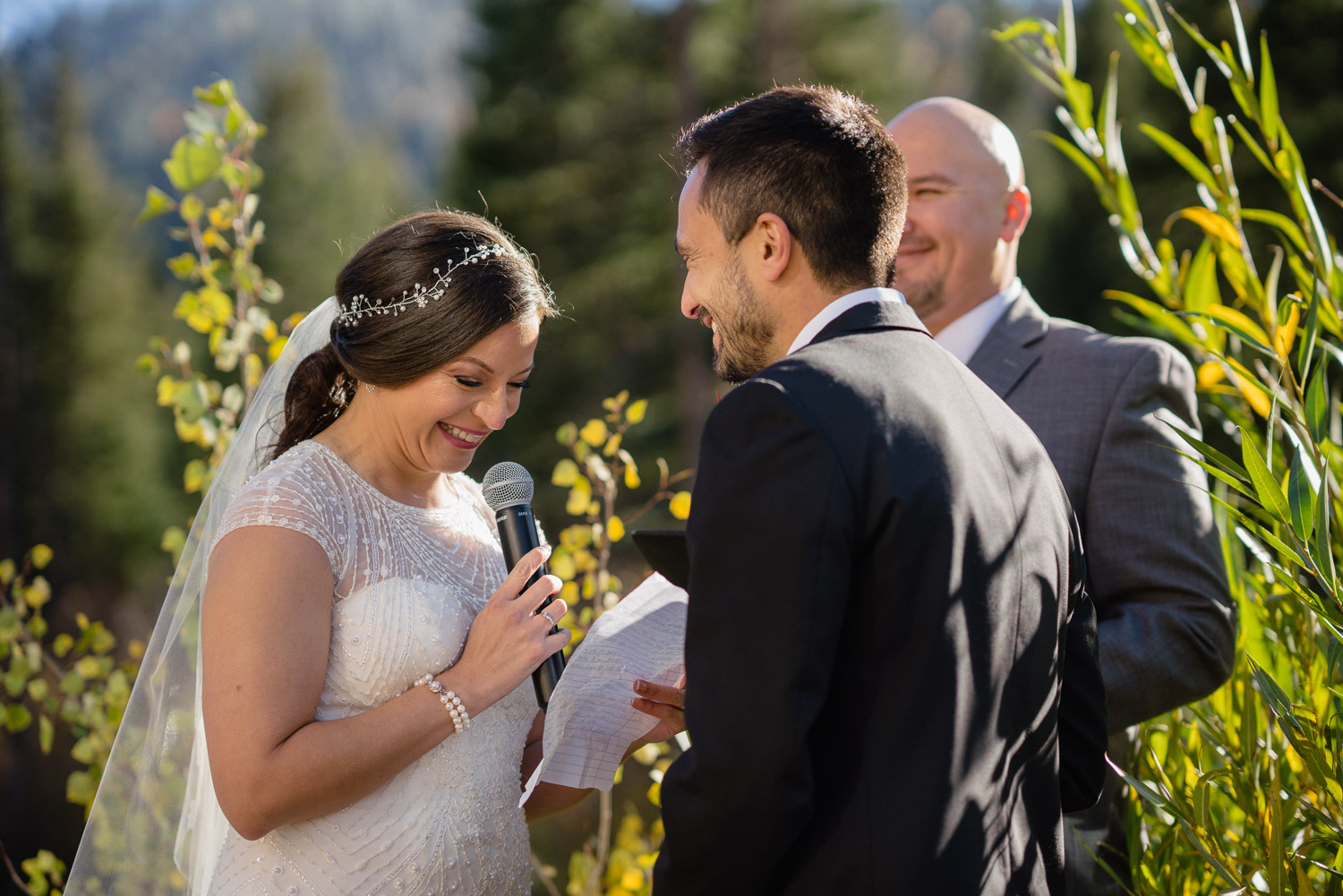 bride smiling reading vows groom smiling outside fall utah wedding