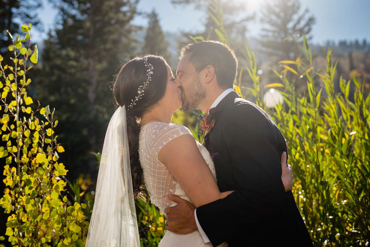 bride and groom kissing outside utah fall wedding solitude