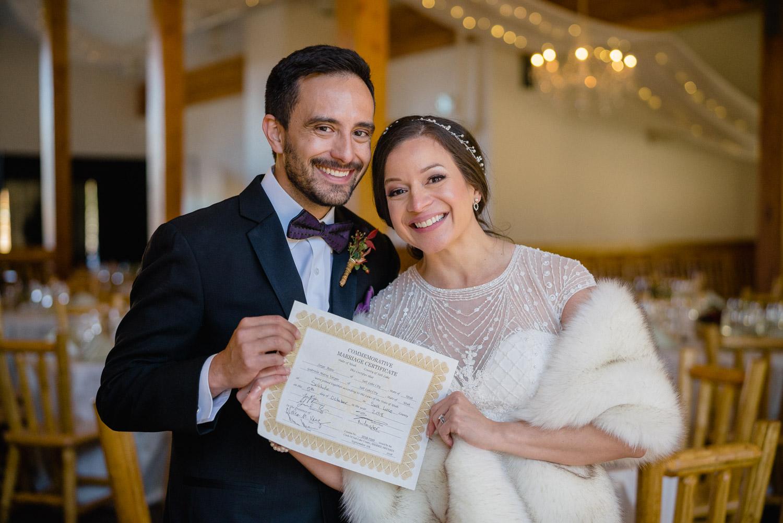 solitude resort bride and groom holding marriage certificate