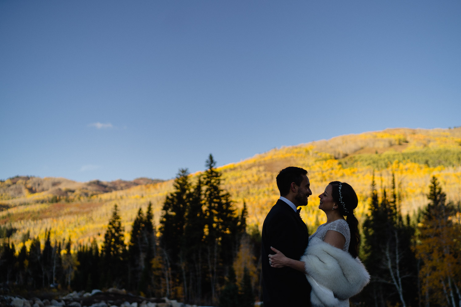 bride and groom hugging outside fall wedding solitude resort