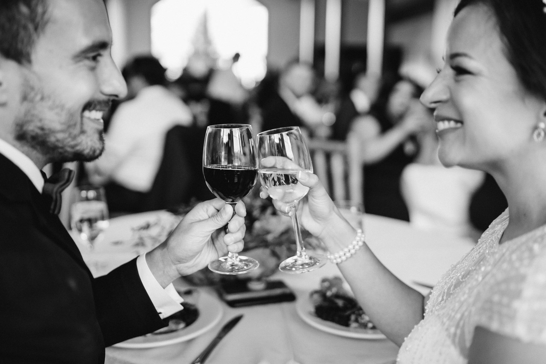happy bride and groom cheers at wedding reception utah solitude mountain resort fall