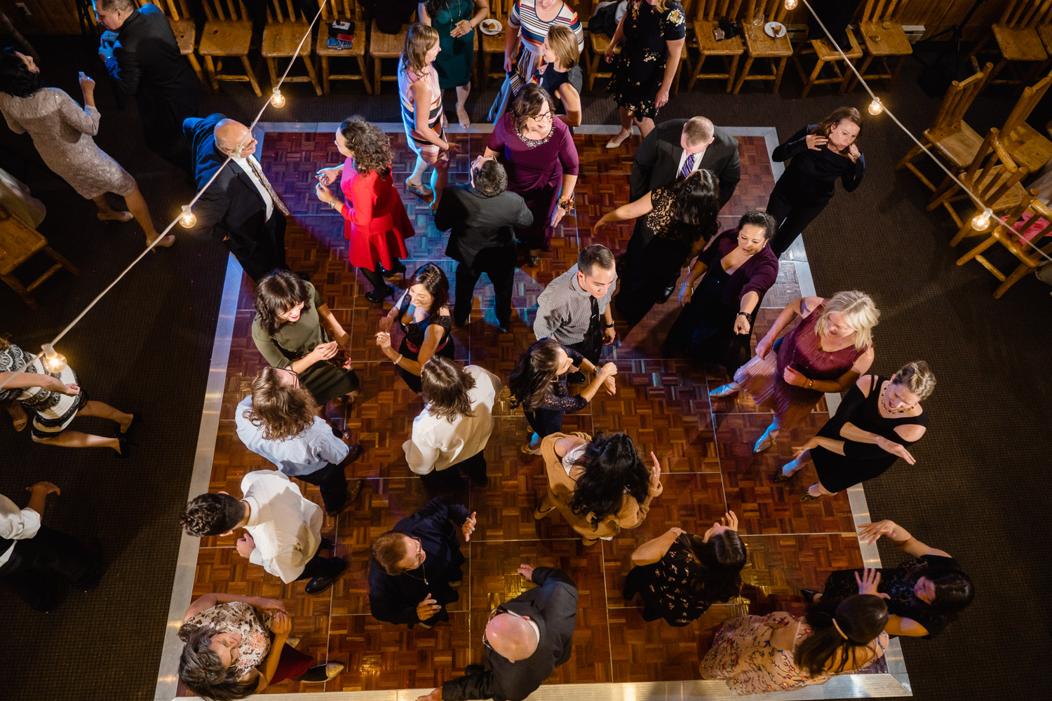 overview of guests dancing at reception utah fall solitude wedding