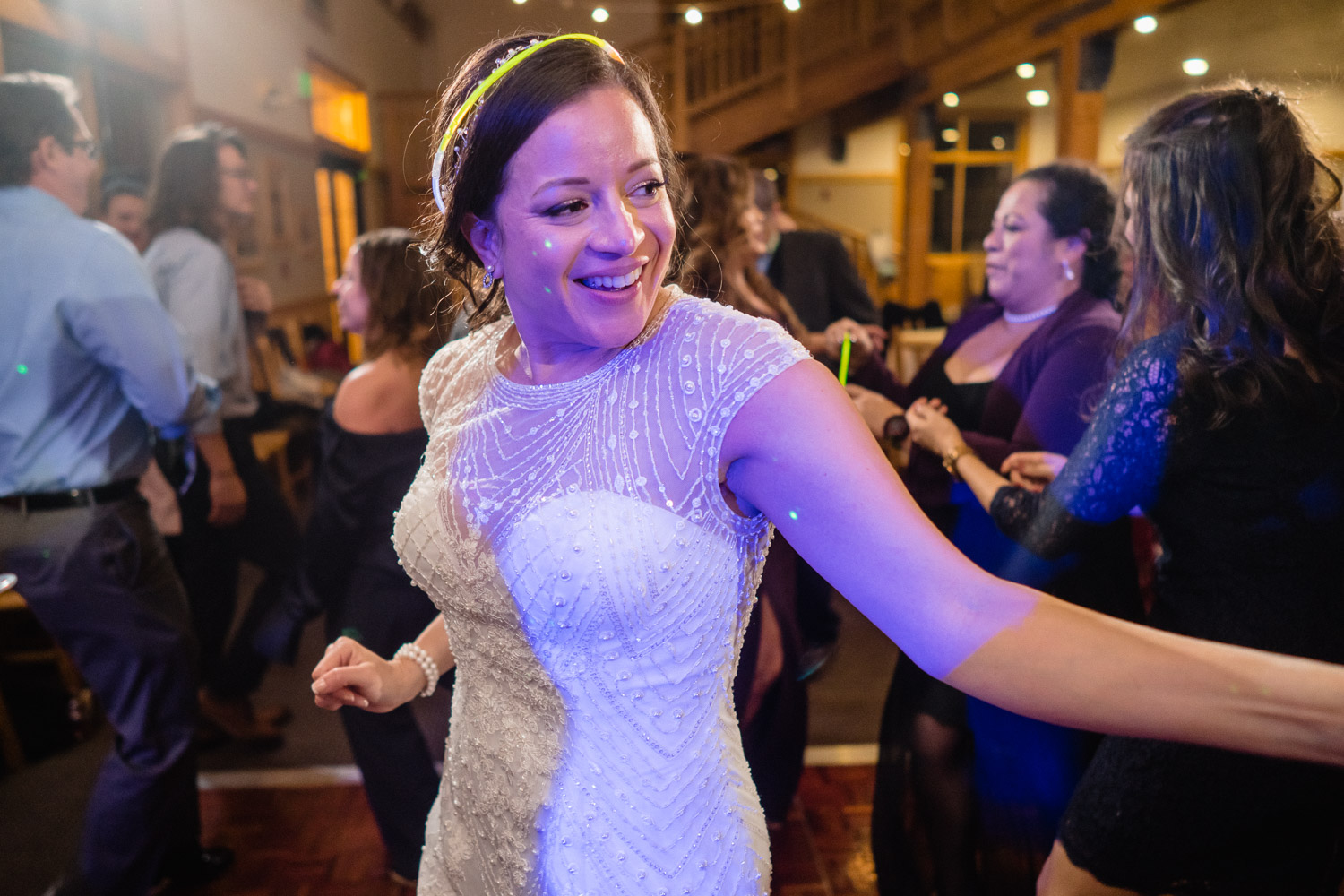 bride dancing with glow stick crown solitude wedding reception