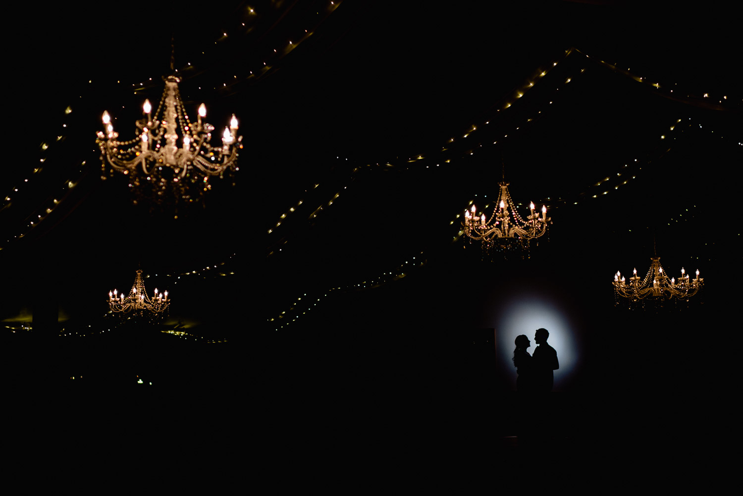 couple dancing under lights at night solitude mountain resort fall wedding