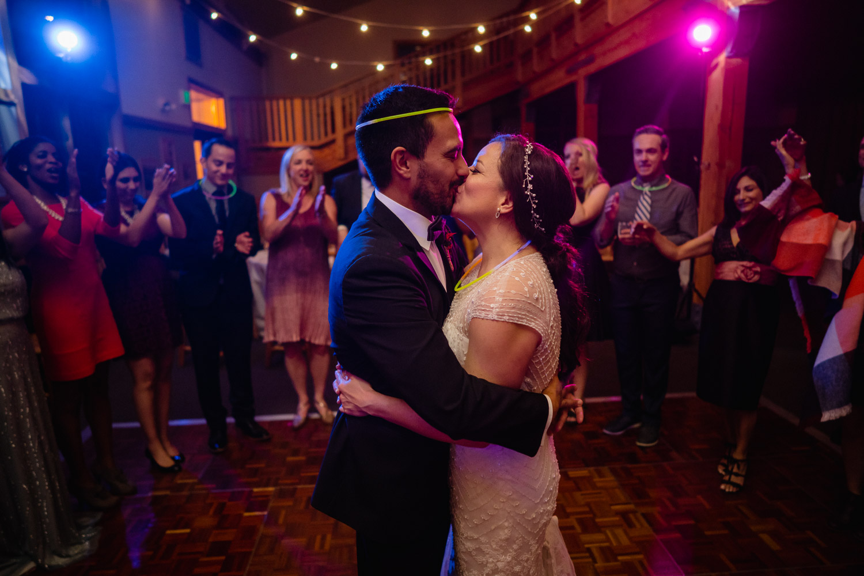 bride and groom kiss on dance floor solitude fall wedding