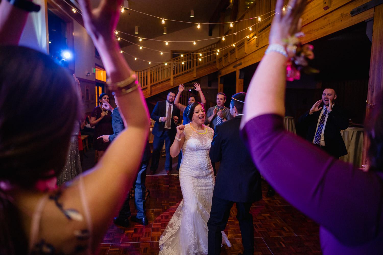 bride groom and guests cheering and dancing solitude wedding