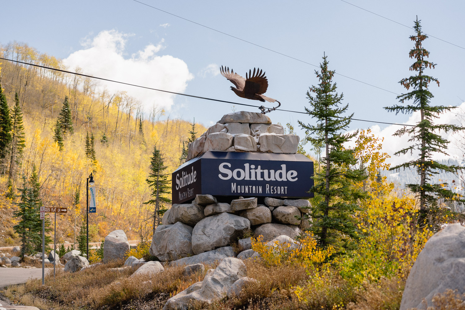 solitude mountain resort sign in sunshine fall trees