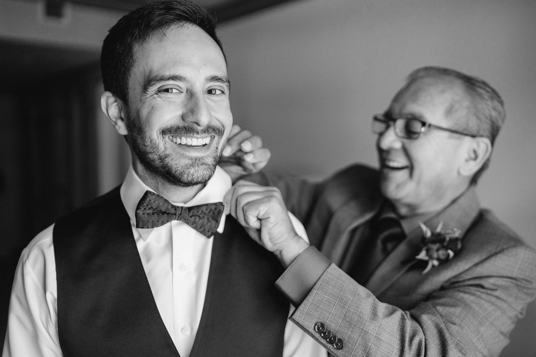 dad straightening groom's collar solitude resort wedding