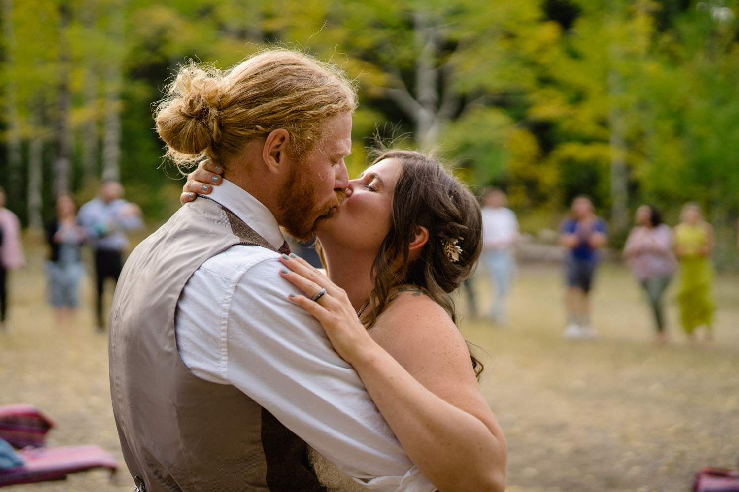 bride and groom kissing outside spruces campground wedding