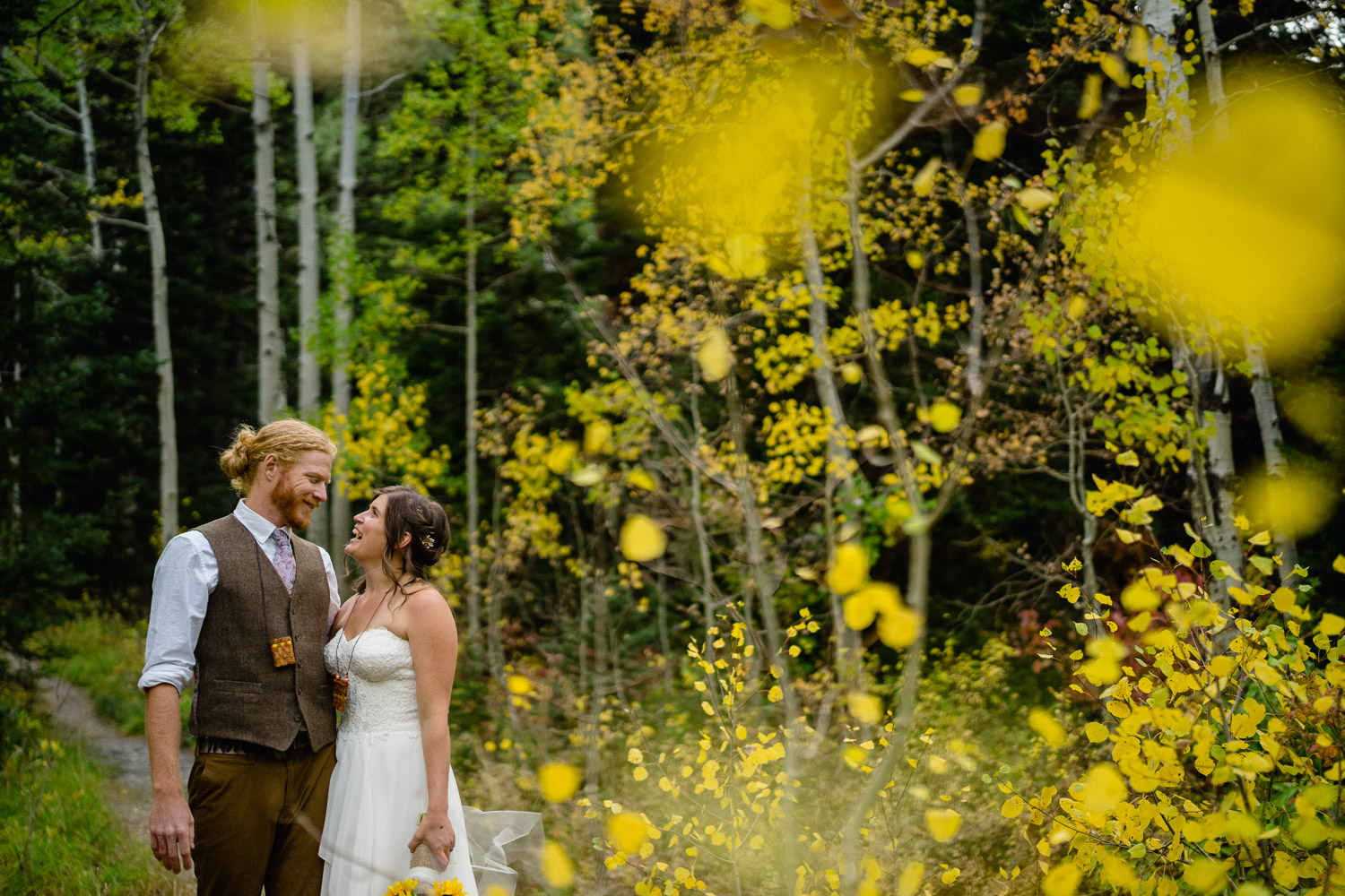 happy couple in aspen trees spruces campground wedding
