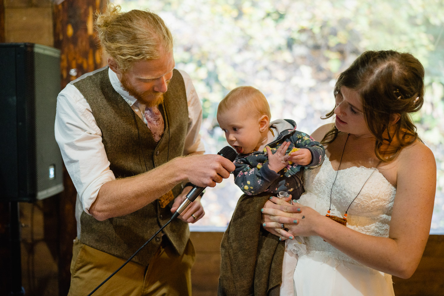 bride groom and baby giving a toast spruces campground wedding