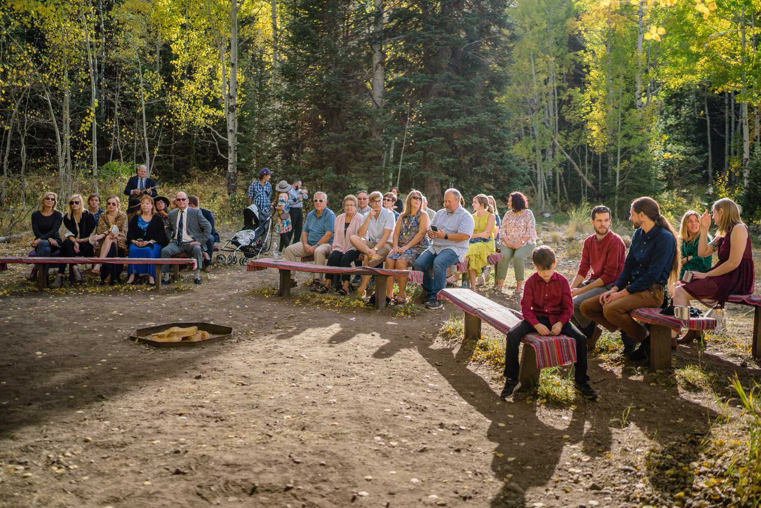 outdoor wedding ceremony guests at spruces campground