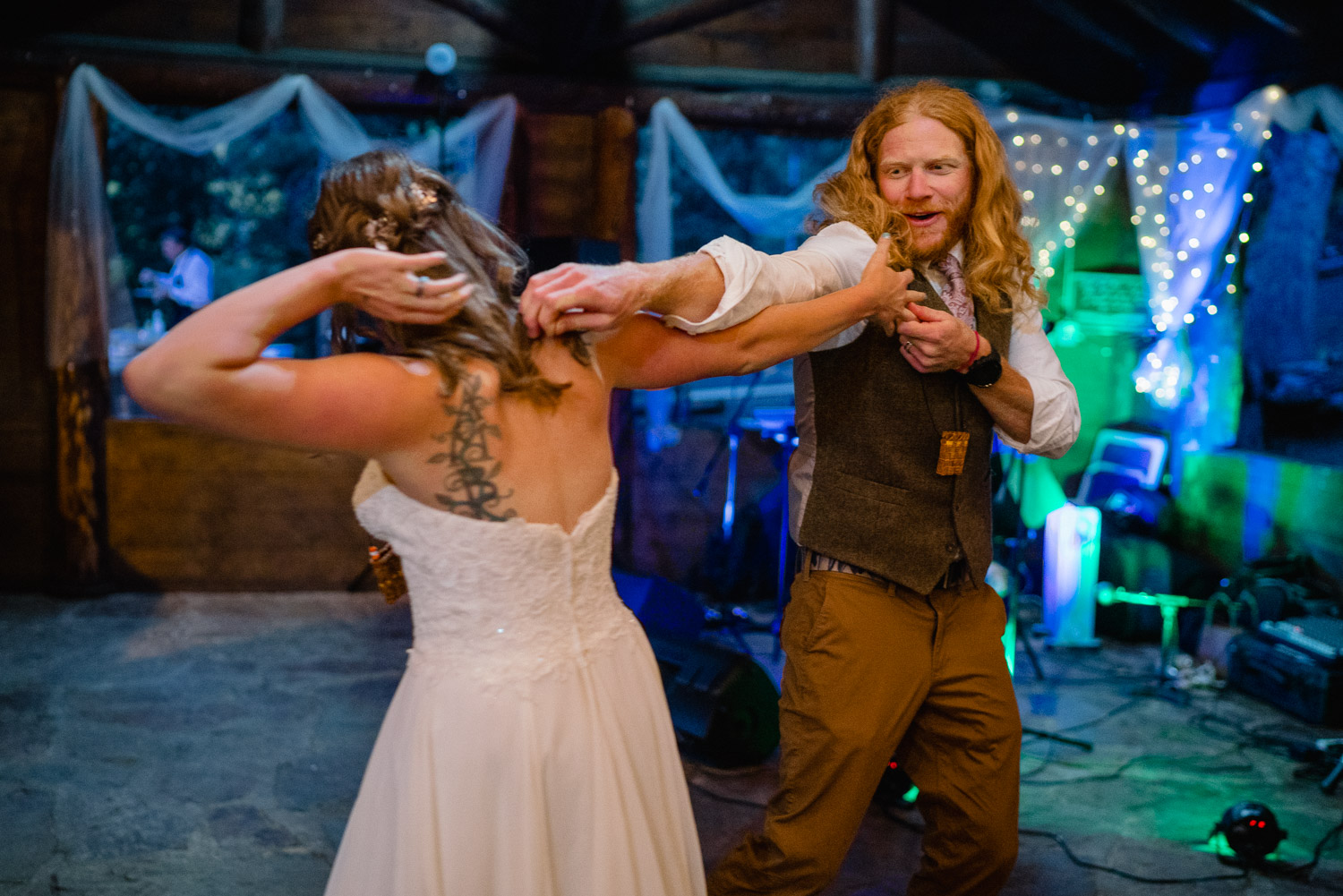bride and groom dance at night campground wedding