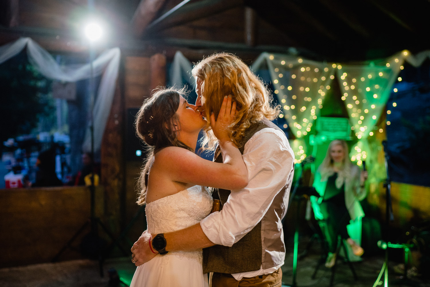 bride and groom kiss outdoor campground reception