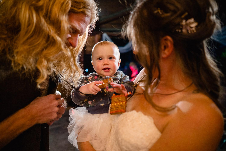 bride groom and baby outdoor reception utah campground wedding