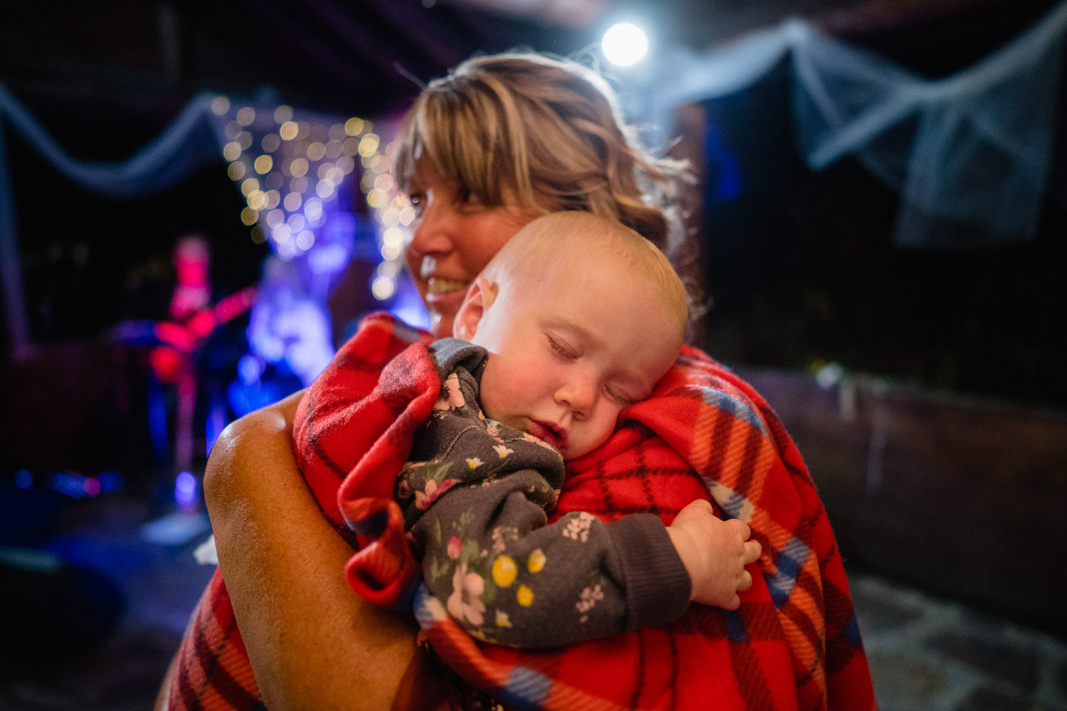 woman cuddling baby outdoor reception spruces campground