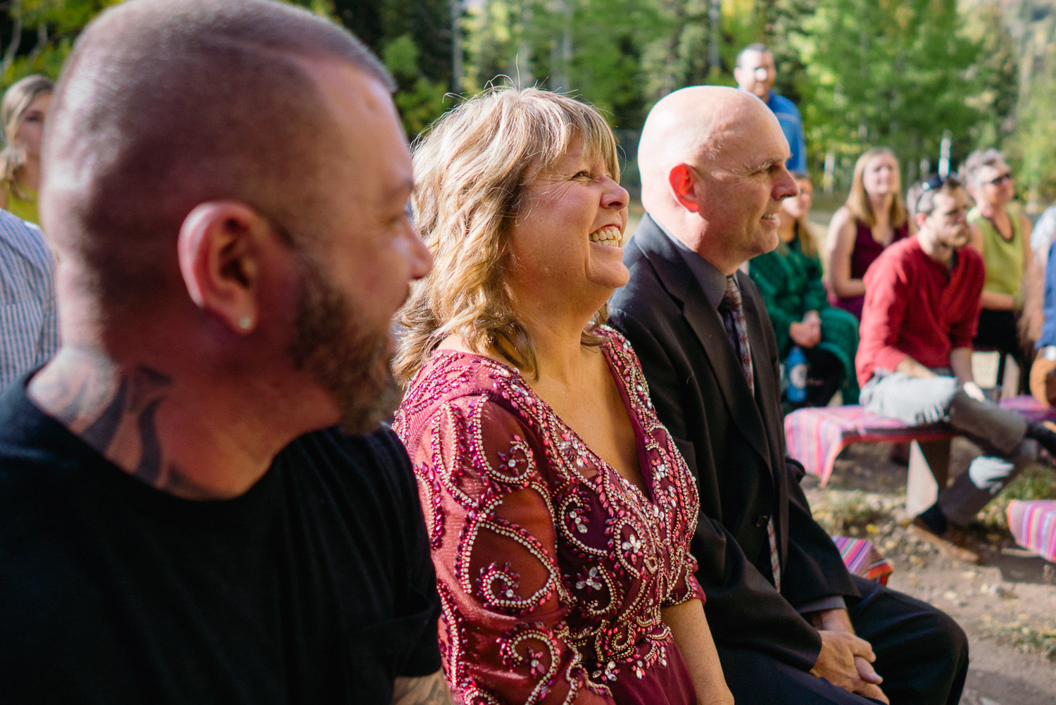 outdoor wedding guests smiling