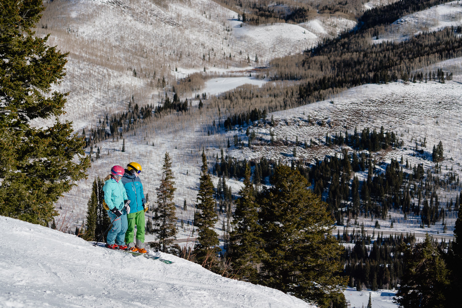 couple in ski gear gazing at mountain view utah ski resort engagements