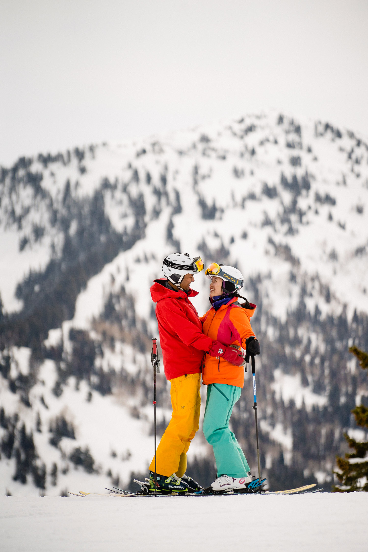 happy engaged couple on snowy mountain at utah ski resort