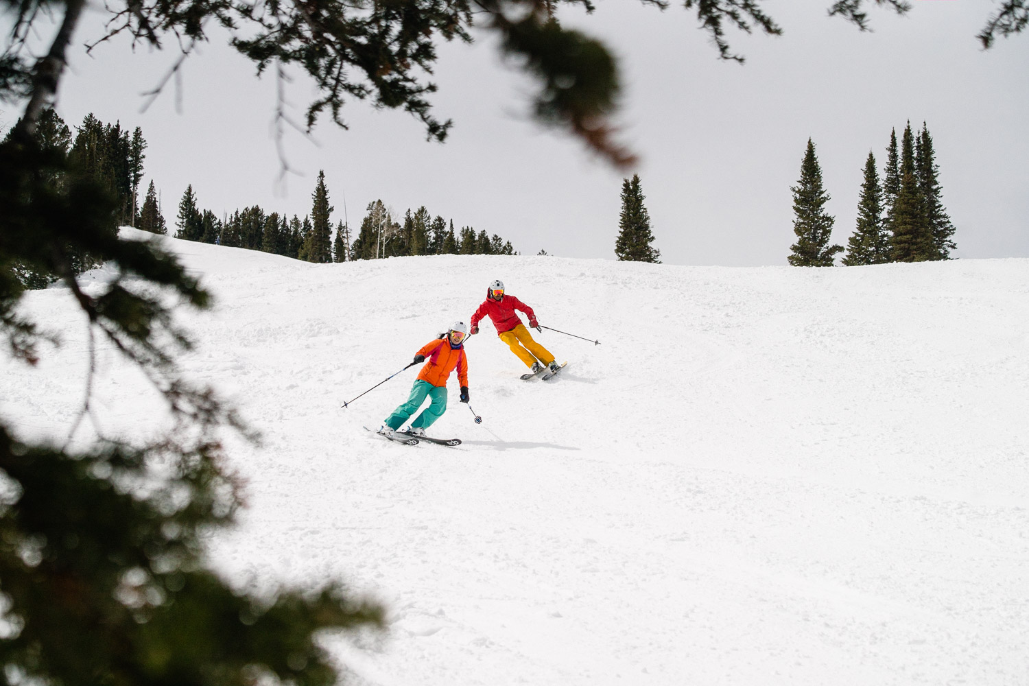 happy couple skiing closely utah ski resort snowy mountain with trees