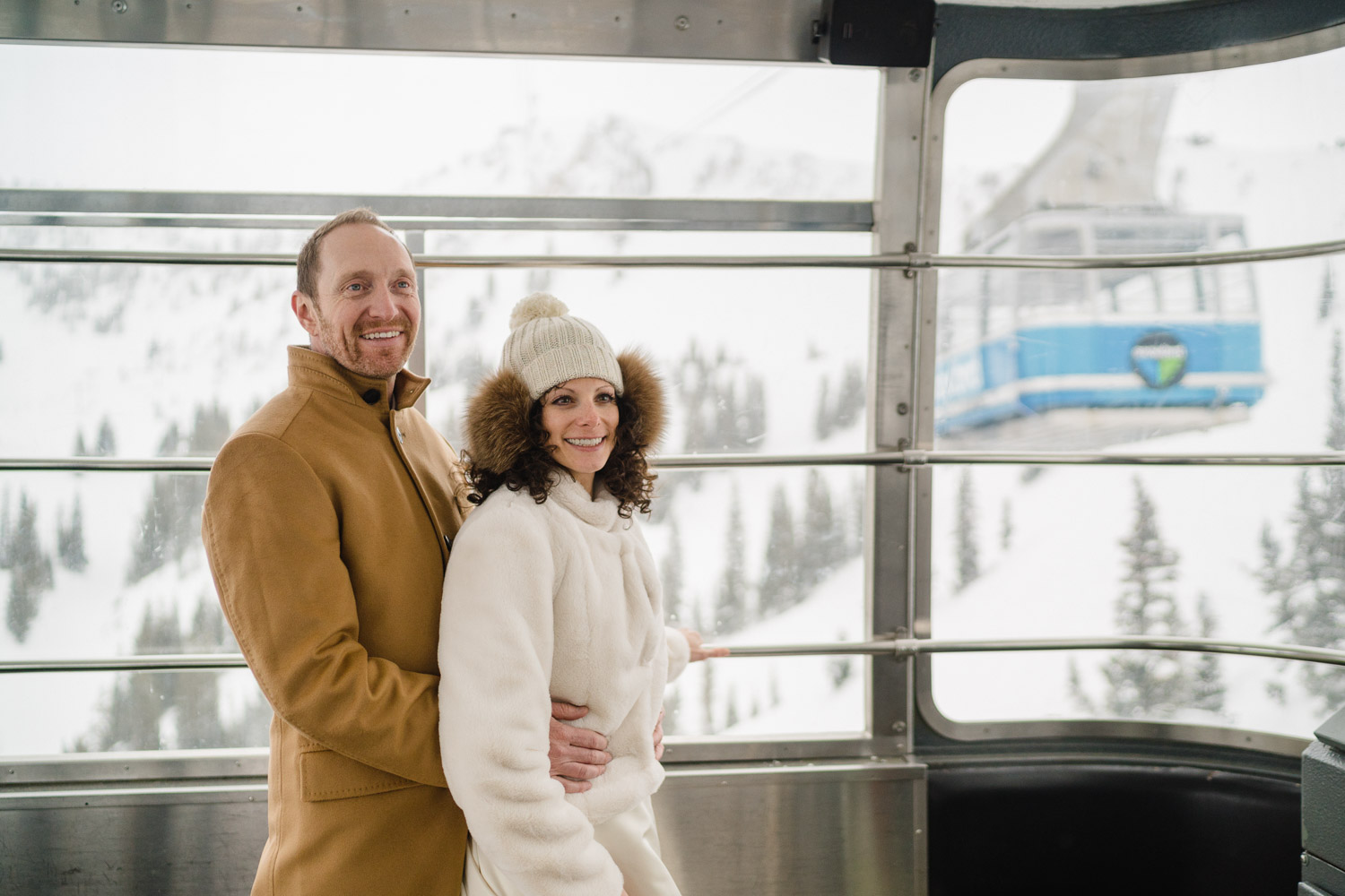 bride and groom smiling in snowbird tram