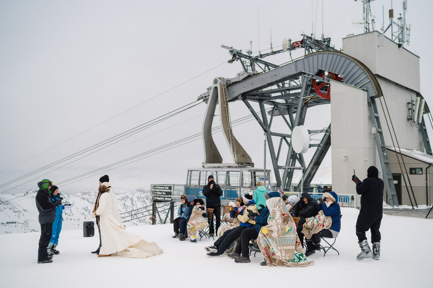snowbird resort mountain top wedding ceremony in snow
