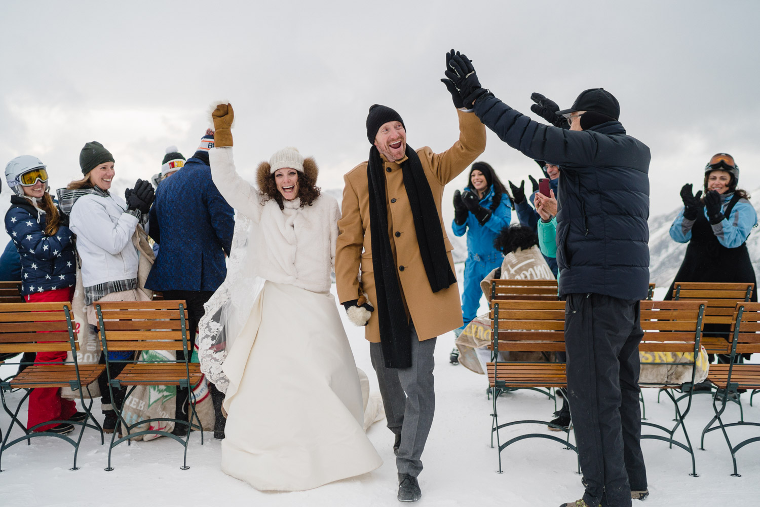 bride and groom celebrating at wedding ceremony on snowy mountain snowbird resort