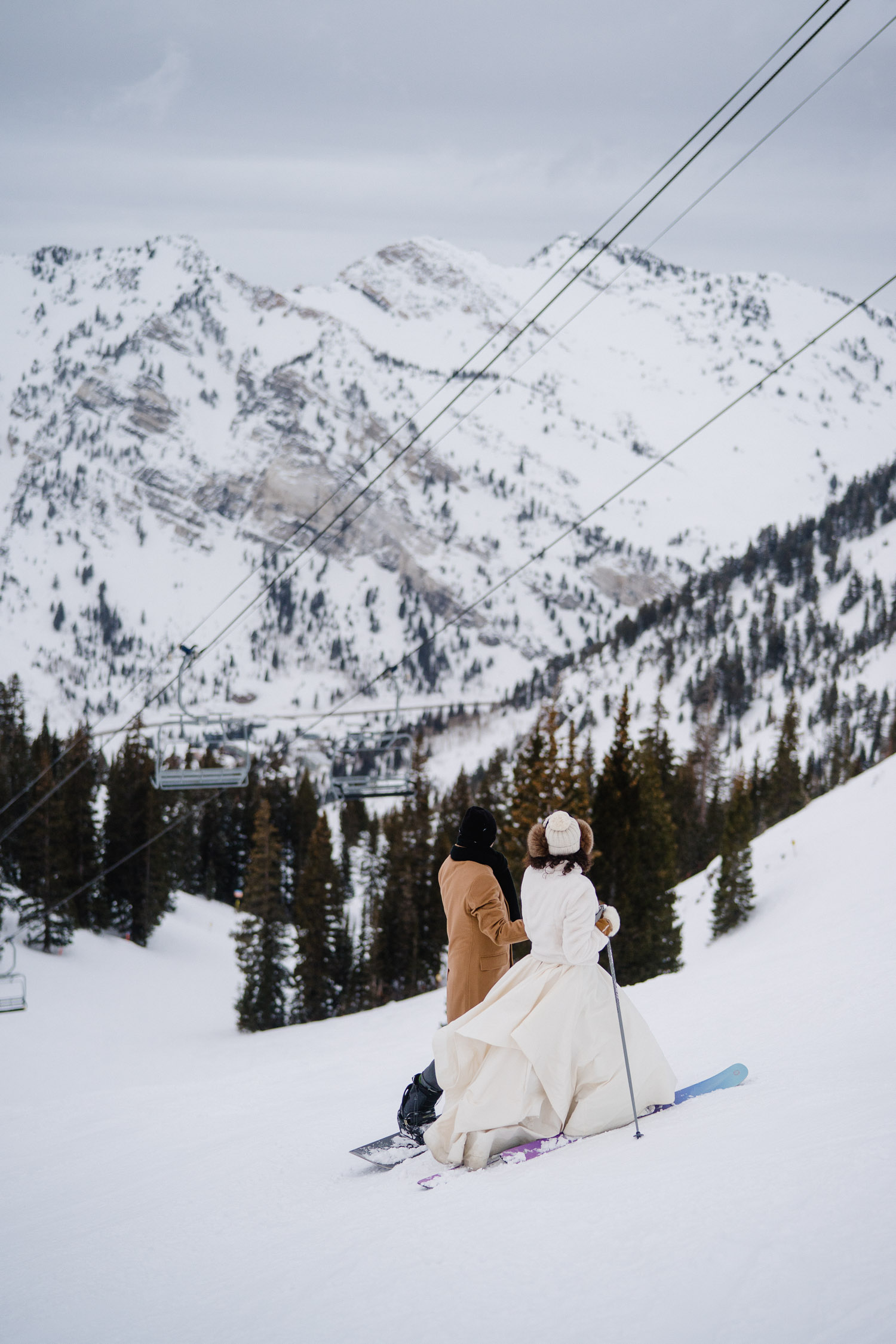 bride and groom under chairlift at snowbird resort