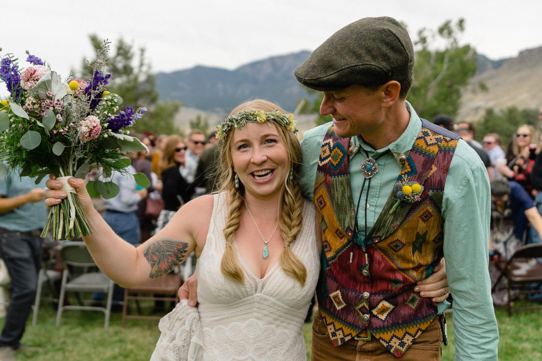 joyful bride and groom after wedding ceremony yellowstone